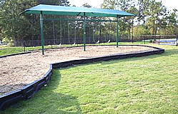 swingset with built-in shade